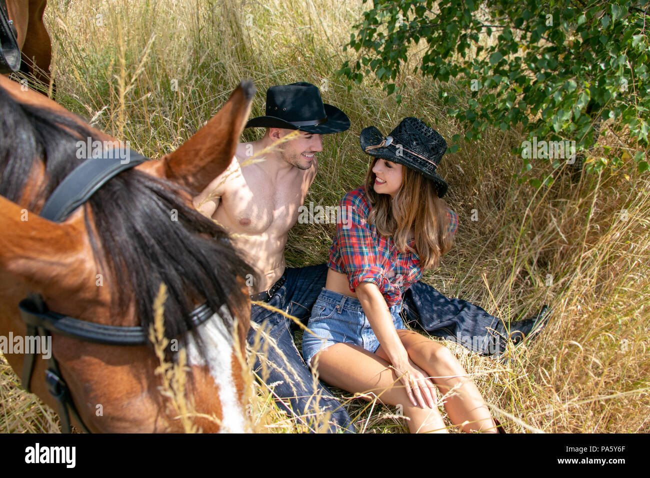 Cowgirl And Cowboy Country And Western Man And Woman With Horse And Saddle On Farm Ranch Stock Photo Alamy