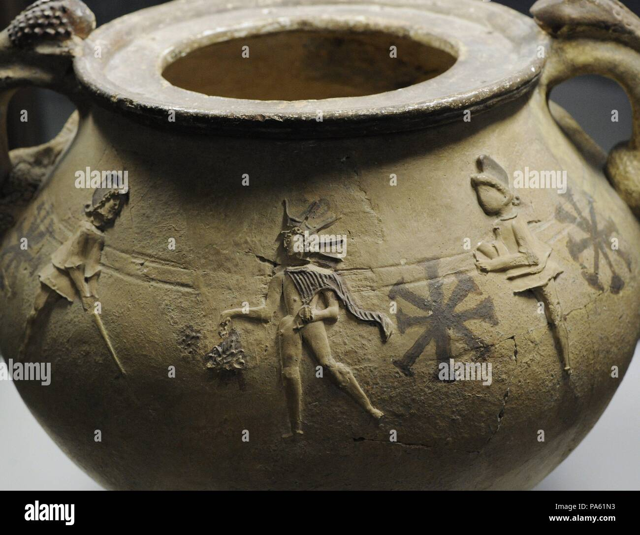 Pottery depicting Mithras surrounded by the torch-bearers Cautes and Cautopates. 2nd-3rd centuries. From Cologne, Germany. Roman-Germanic Museum. Cologne. Germany. - Stock Image