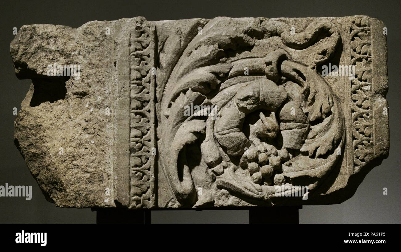 Detail of the left jamb of a monumental door decorated with acanthus leaves, a squirrel and a snake. Limestone and marble. Roman-Germanic Museum. Cologne. Germany. - Stock Image