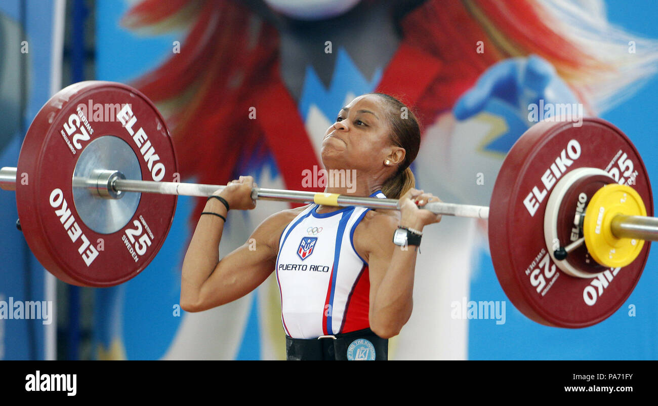 Barranquilla, Colombia. 20th July, 2018. Puerto Rican Lely Berlitt Burgos competes at 48kg women weighlifting during the Central American and Caribbean Games 2018, in Barranquilla, Colombia, 20 July 2018. Segura won the gold medal in 97kg. Credit: Luis Eduardo Noriega A./EFE/Alamy Live News - Stock Image