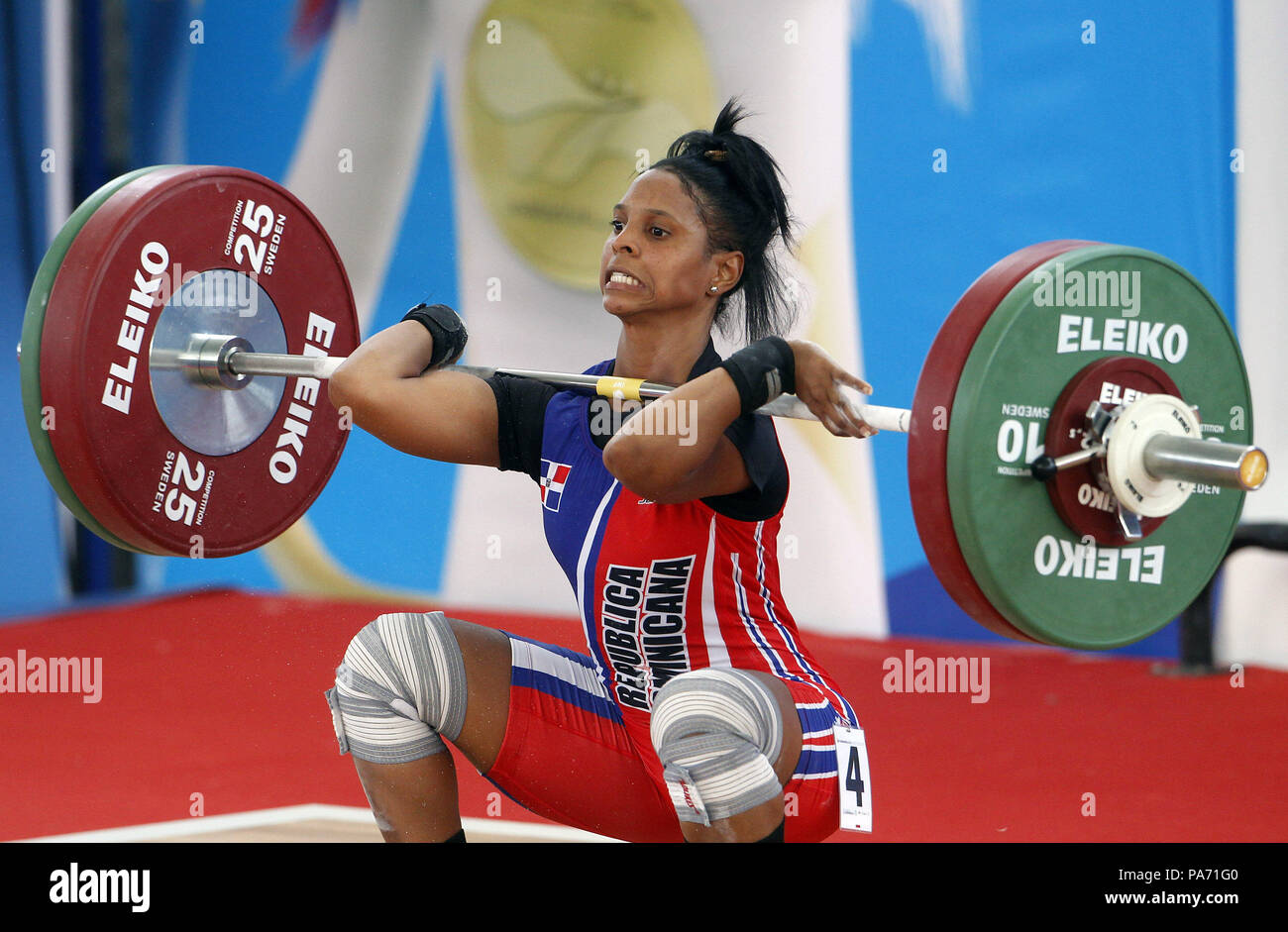 Barranquilla, Colombia. 20th July, 2018. Dominican Santa Dolorita Cotes competes at 48kg women weighlifting during the Central American and Caribbean Games 2018, in Barranquilla, Colombia, 20 July 2018. Segura won the gold medal in 97kg. Credit: Luis Eduardo Noriega A./EFE/Alamy Live News - Stock Image