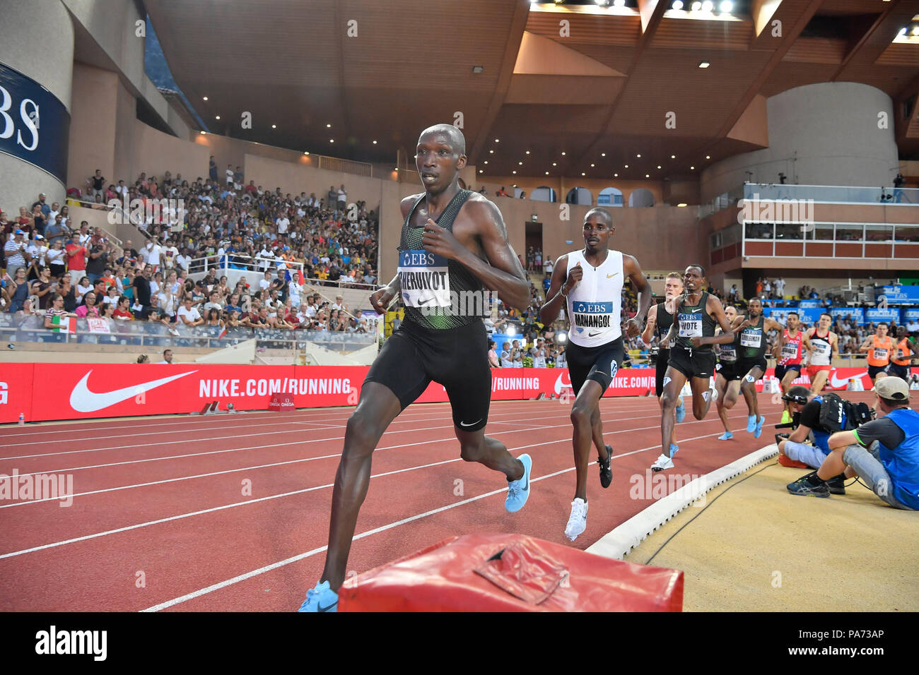 Fontvieille. 20th July, 2018. Timothy Cheruiyot (front) of Kenya competes during the men's 1500m match at the IAAF Diamond League athletics 'Herculis' meetings in Fontvieille, Monaco on July 20, 2018. Timothy Cheruiyot claimed the title in a time of 3:28.41. Credit: Chen Yichen/Xinhua/Alamy Live News - Stock Image