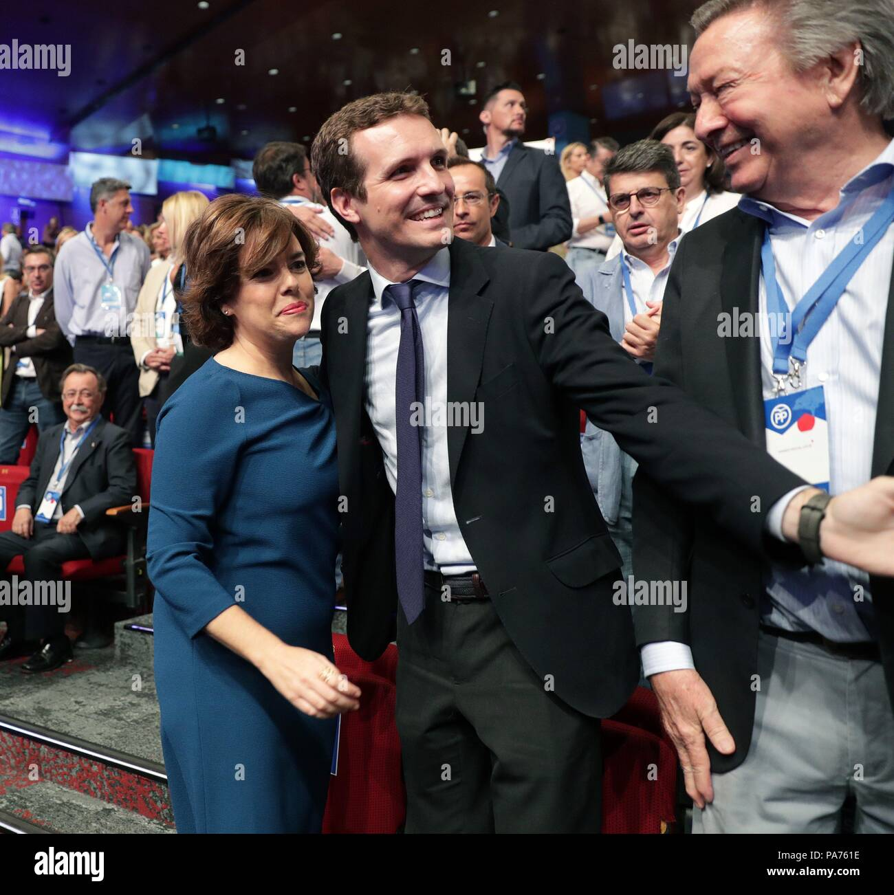 Madrid spain 21 july 2018 candidates to lead the spanish candidates to lead the spanish conservative peoples party pp pablo casado c and soraya saenz de santamaria l greet each other during the peoples m4hsunfo