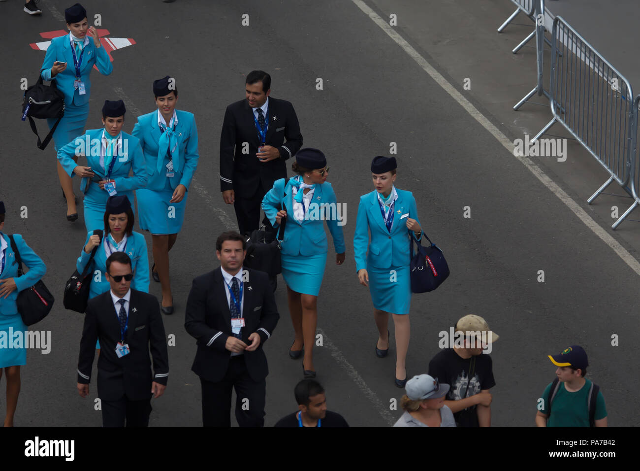 Farnborough,UK,21st July 2018,Cabin crew at Farnborough International Airshow 2018 which gets off to a flying start as it opens its doors to the public this weekend. Huge crowds attend as various planes, old and new take to the skies including the ever popular Red Arrows and Battle of Britain Memorial Flight.Credit: Keith Larby/Alamy Live News - Stock Image