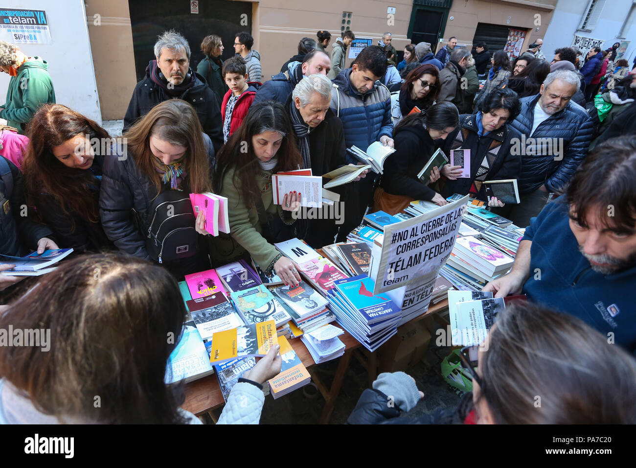 Writers, journalists, booksellers and workers of the Argentine State-Run News Agency (Télam) organised  today in front of the agency building a book swap in order to raise awareness on the conflict over the dismissal of 357 workers by Mauricio Macri's Administration. Stock Photo