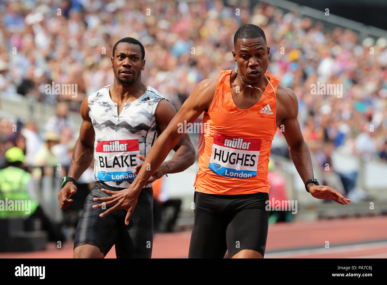 London, UK. 21st July 18. Akani SIMBINE (South Africa), Zharnel HUGHES (Great Britain) crossing the finish line in the Men's 100m Final at the 2018, IAAF Diamond League, Anniversary Games, Queen Elizabeth Olympic Park, Stratford, London, UK. Credit: Simon Balson/Alamy Live News - Stock Image
