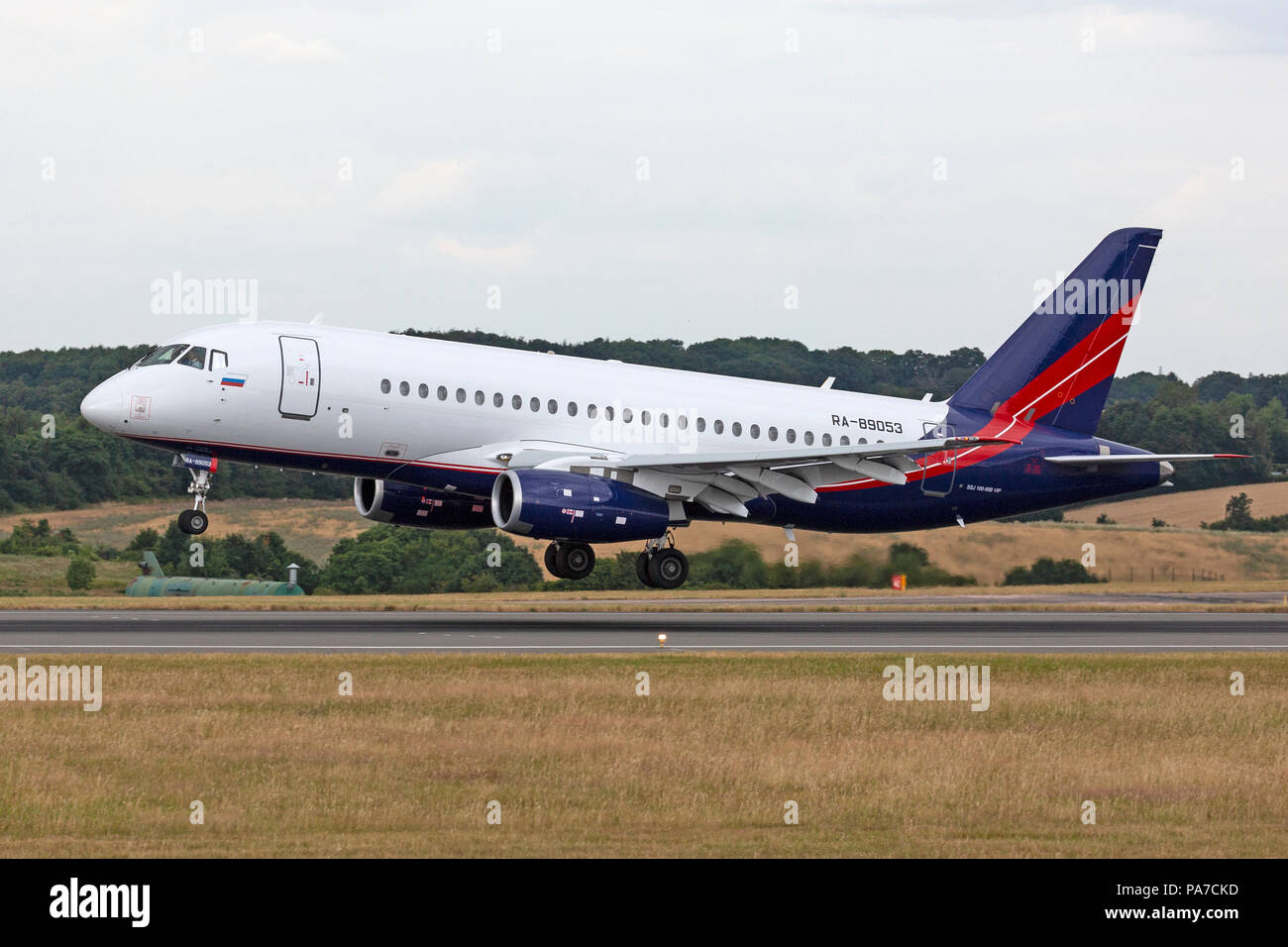 A Sukhoi Superjet SU-100 executive business jet aircraft, registered Russia as RA-89053, at London Luton Airport in England. - Stock Image