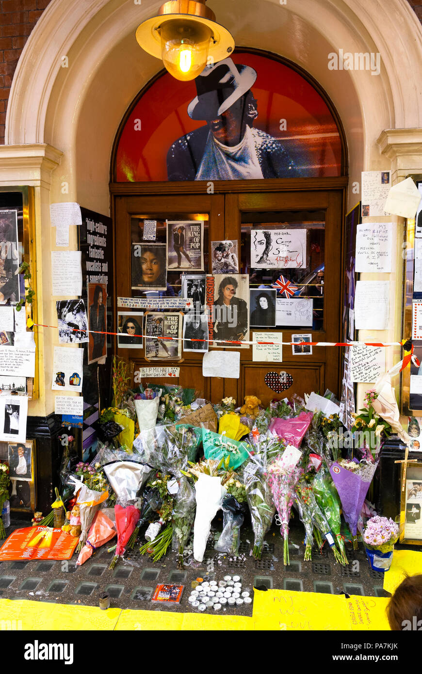 Tributes outside the Lyric Theatre in Shaftesbury Avenue after the sudden death of Michael Jackson where 'Thriller Live' concert is performed in Londo - Stock Image