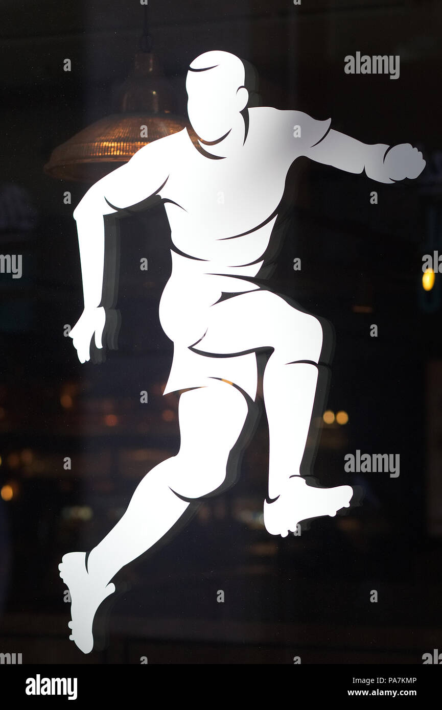 footballer in action window sticker - Stock Image