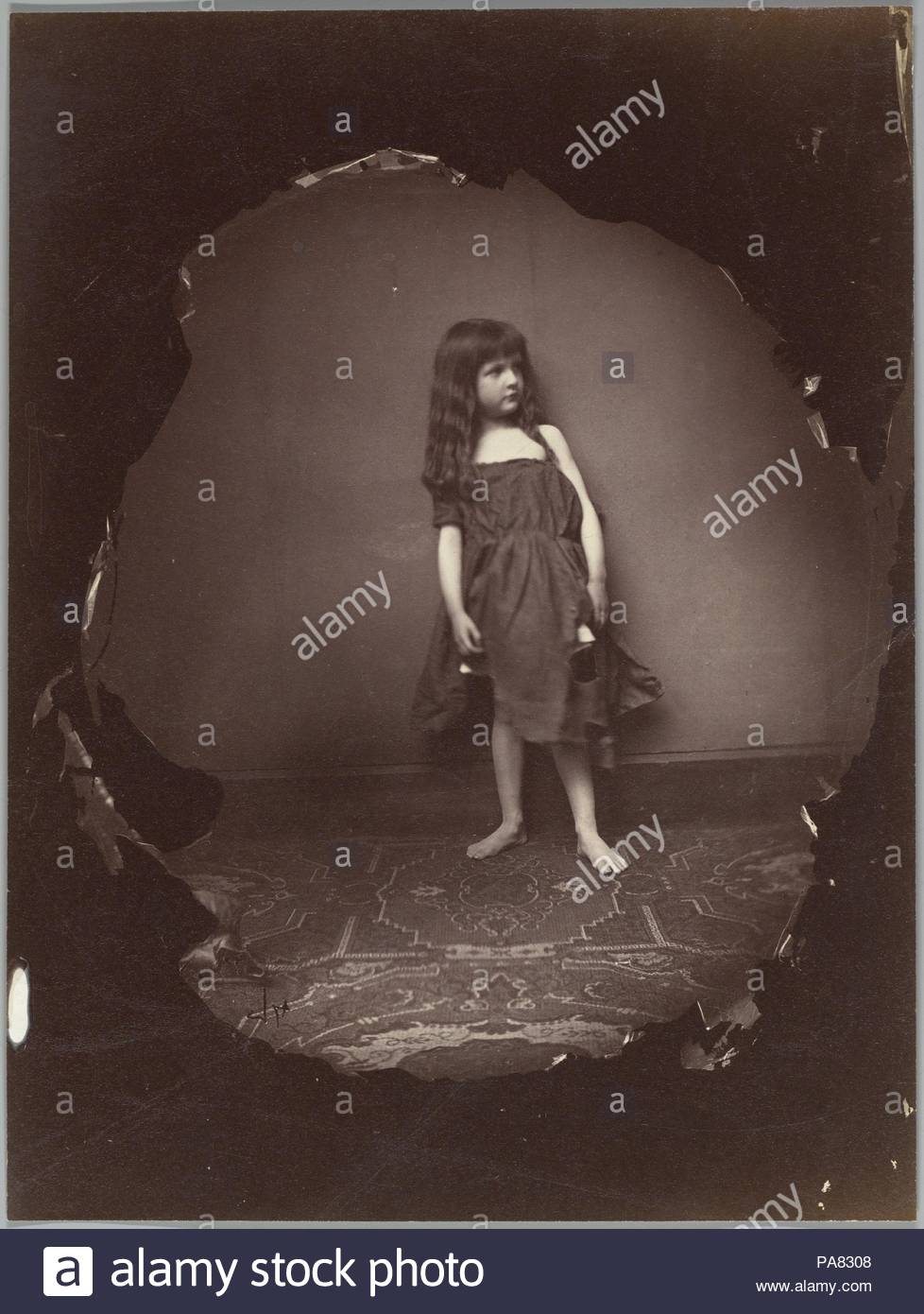 'The Prettiest Doll in the World'. Artist: Lewis Carroll (British, Daresbury, Cheshire 1832-1898 Guildford). Dimensions: 7 3/4 x 5 13/16. Subject: Alexandra 'Xie' Rhoda Kitchin (British, 1864-1925). Date: July 5, 1870.  The Reverend Charles Lutwidge Dodgson, a mathematics professor at Oxford better known by his pen name, Lewis Carroll, often photographed friends' children outfitted in storybook costumes, playacting the sorts of fantastic scenes that appear in his writing. The model in this photograph, Alexandra 'Xie' Kitchin, posed more than fifty times over eleven years, frequently for images - Stock Image