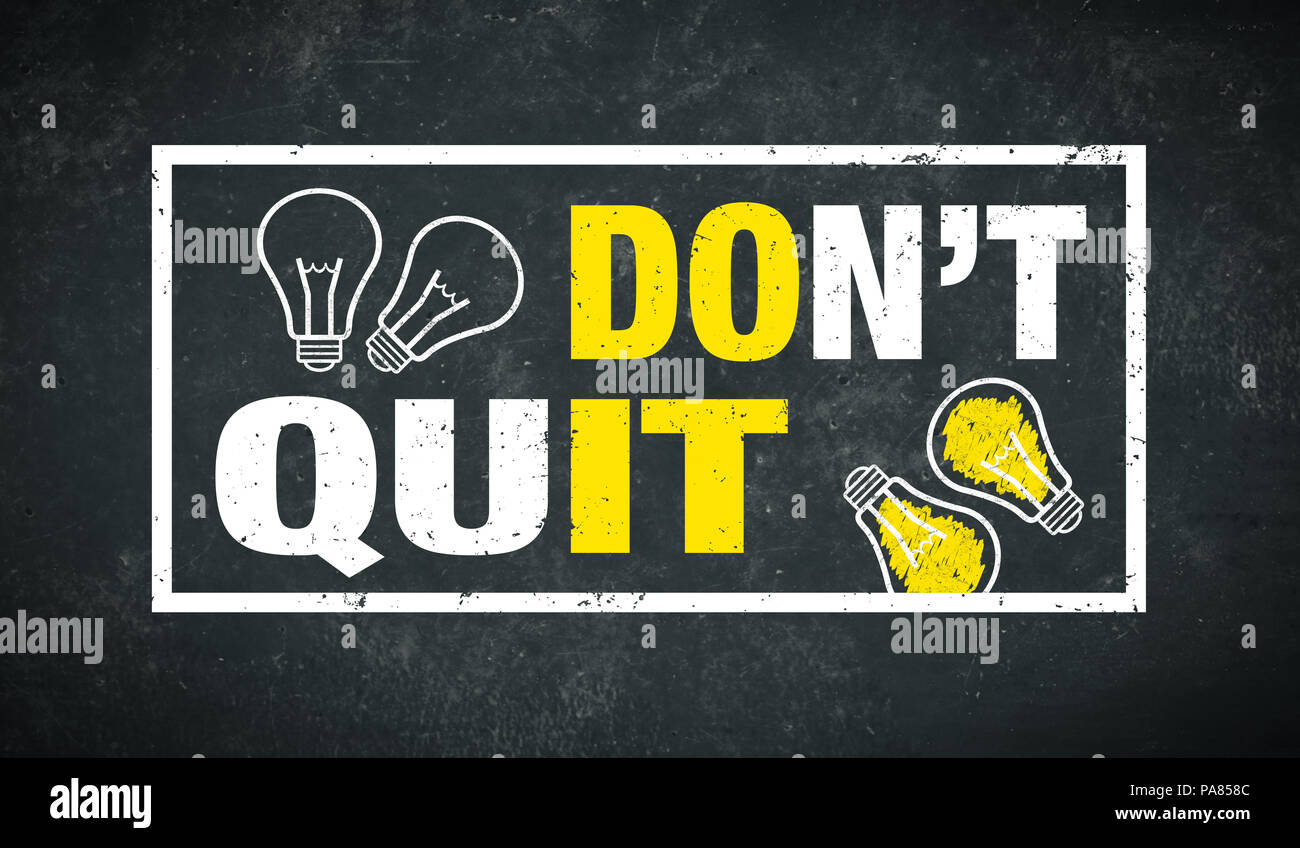 Don't quit - do it - text and lightbulbs on a chalkboard - Stock Image