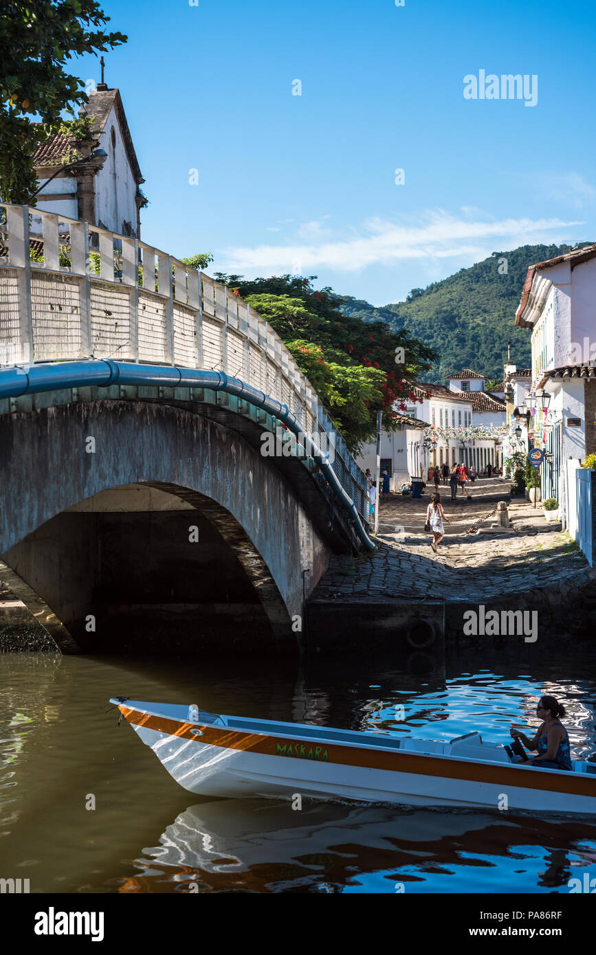 Paraty, Brazil - February 28, 2017: An iconic view of the canal and the colonial houses of the historic town Paraty, Rio de Janeiro state, Brazil - Stock Image