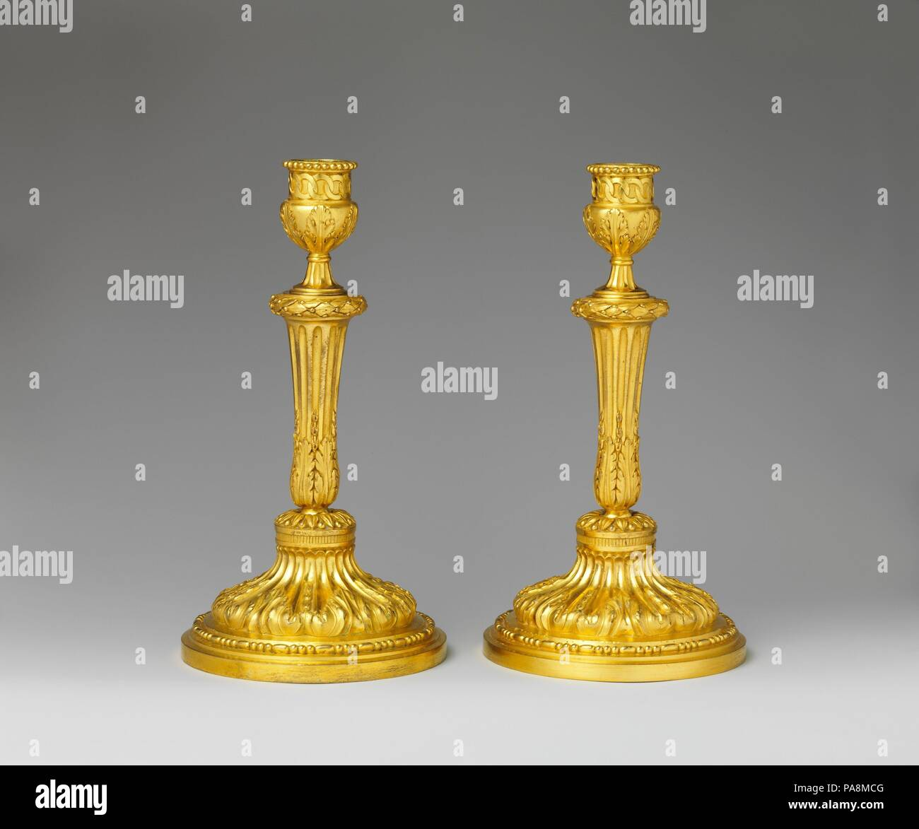Pair of candlesticks. Culture: French. Dimensions: Overall (confirmed): 10 1/2 x 5 5/8 in. (26.7 x 14.3 cm). Date: ca. 1770-75. Museum: Metropolitan Museum of Art, New York, USA. Stock Photo