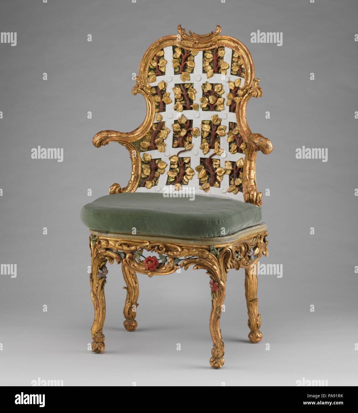Armchair (one of a pair) (part of a set). Culture: German, Würzburg. Dimensions: 44 x 26 x 21 in. (111.8 x 66 x 53.3cm). Maker: Attributed to Johann Michael Bauer (German, Westheim 1710-1779 Bamberg). Date: ca. 1763-64.  The settees and chairs illustrated here (see 1974.356.114-.121) were made for the Franckenstein Pavilion in the gardens of Seehof Castle near Bamberg, one of the three summer residences in Southern Germany used by Adam Friedrich von Seinsheim, prince bishop of Würzberg and Bamberg. A true garden enthusiast, it was under von Seinsheim that the gardens of Seehof were embellished - Stock Image