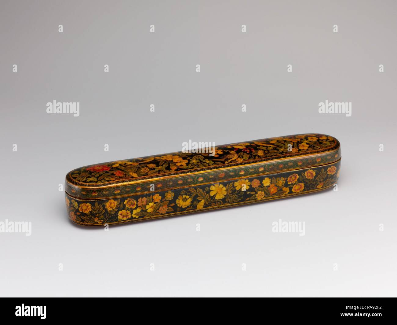 Pen Box with a Europeanizing Landscape. Artist: Hajji Muhammad. Dimensions: LengtH. 11 in. (27.9 cm)  WidtH. 2 1/4in. (5.7cm). Date: late 17th-early 18th century.  This pen box is signed by the later Safavid artist Haji Muhammad. The Europeanized landscape depicted on the inside cover of this box is associated with the style of this artist and other members of his family, most famously his celebrated brother Muhammad Zaman. The high status accorded to the arts of calligraphy and writing in the Islamic world led to the production of many handsome accessories such as this pen box. Museum: Metrop Stock Photo