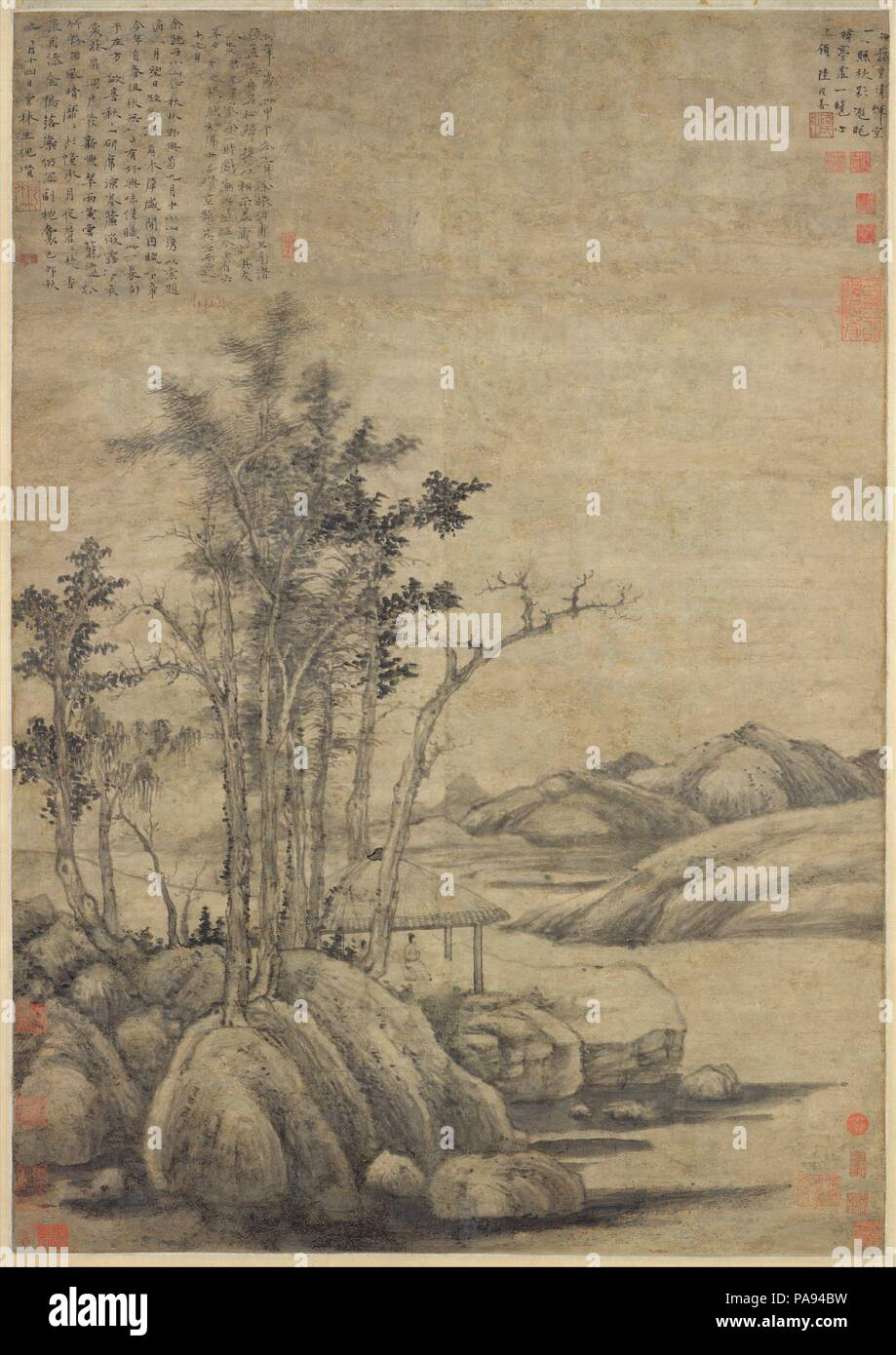 Enjoying the Wilderness in an Autumn Grove. Artist: Ni Zan (Chinese, 1306-1374). Culture: China. Dimensions: Image: 38 5/8 x 27 1/8 in. (98.1 x 68.9 cm)  Overall with mounting: 106 7/8 x 35 7/8 in. (271.5 x 91.1 cm)  Overall with knobs: 106 7/8 x 40 in. (271.5 x 101.6 cm). Date: dated 1339.  Until the early 1340s, Ni Zan lived the life of a wealthy dilettante, spending his time among the precious books, antiques, and flowers of his Pure and Secluded Pavilion. His painting style at the time, as seen here, exhibits a studied archaism in which his interest in descriptive detail is at odds with hi Stock Photo