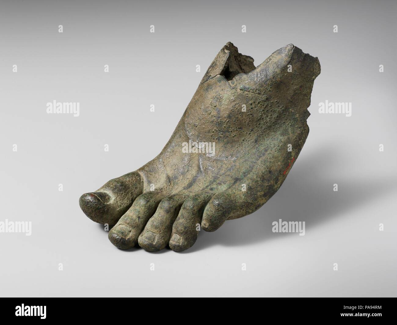 Bronze left foot with traces of sandal straps. Culture: Roman. Dimensions: Overall: 4 7/8 x 9 5/16 in. (12.4 x 23.7 cm). Date: 1st or 2nd century A.D.  Left foot with sandal straps. Museum: Metropolitan Museum of Art, New York, USA. - Stock Image