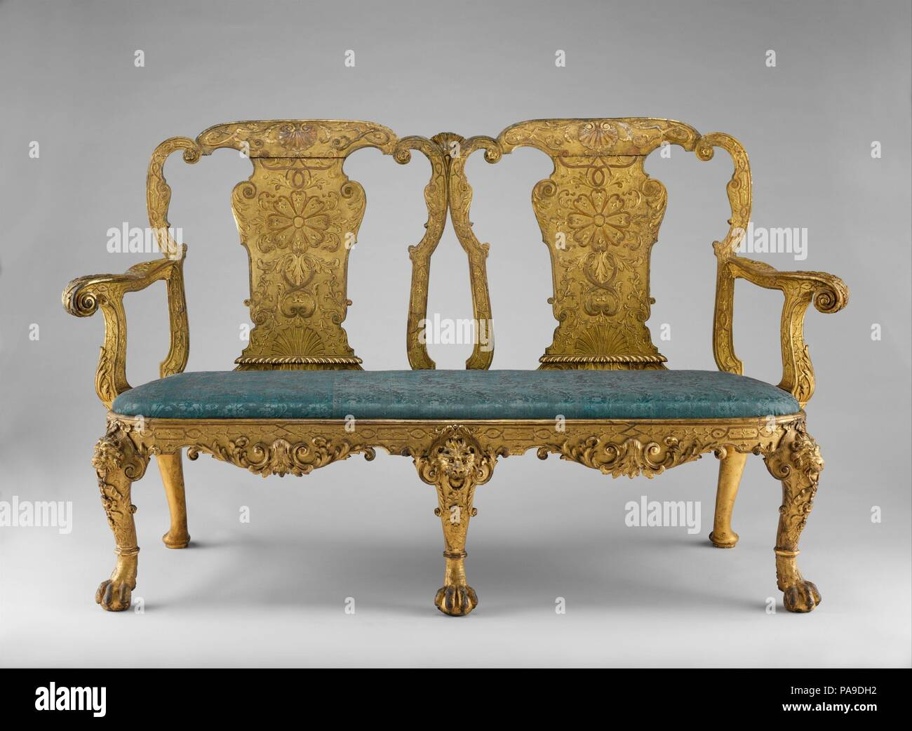 Settee. Culture: British. Dimensions: Overall: 41 × 67 1/2 × 26 in. (104.1 × 171.5 × 66 cm). Date: ca. 1730-35.  This piece is from a large set of at least eight side chairs, four settees, four stools, and two side tables formerly attributed to James Moore (ca. 1670-1726) and said to have been made for Stowe, Buckinghamshire, a provenance now questioned. Museum: Metropolitan Museum of Art, New York, USA. - Stock Image