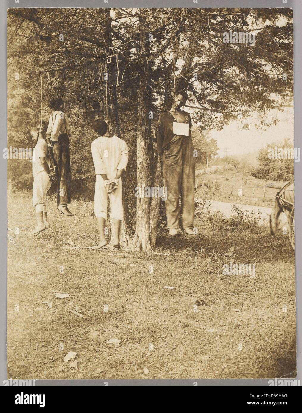[Lynching, Russellville, Kentucky]. Artist: Minor B. Wade (American, 1874-1932). Dimensions: Image: 11.8 x 9.1 cm (4 5/8 x 3 9/16 in.). Date: 1908.  From the first year of Reconstruction to the early 1940s, lynching was the primary means of maintaining white supremacy in the American South. Considered by the federal government a normal condition of post-Civil War race relations, lynching was used not only as a specific act of summary 'justice' but also as a symbol to further intimidate and degrade blacks. The magnitude of recorded mob violence between 1880 and 1940 almost defies description, i - Stock Image