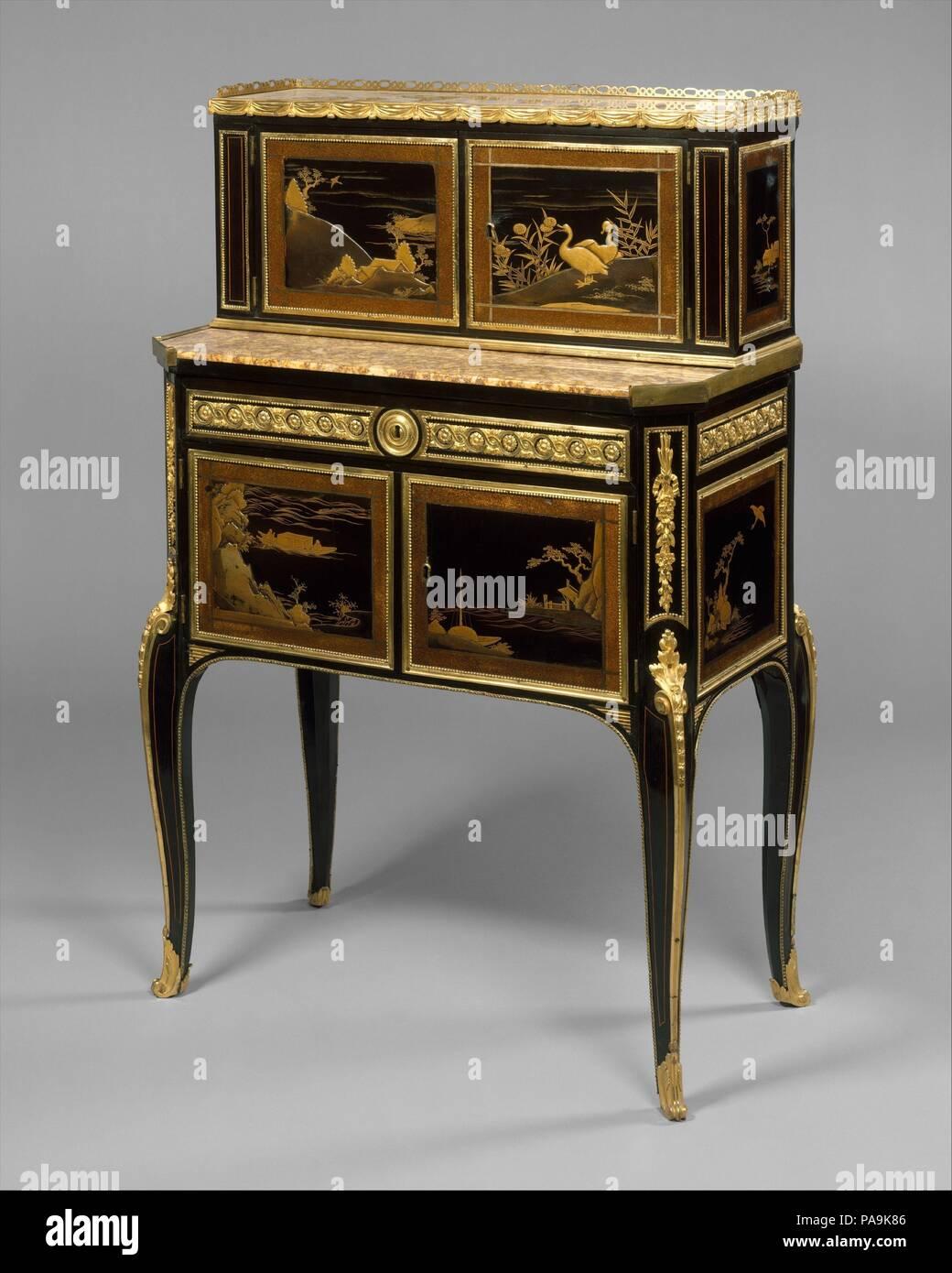 Desk (bonheur du jour). Culture: French. Dimensions: 39 x 25 1/4 x 14 1/2 in. (99.1 x 64.1 x 36.8cm). Maker: Claude-Charles Saunier (French, 1735-1807). Date: ca. 1765-75. Museum: Metropolitan Museum of Art, New York, USA. - Stock Image