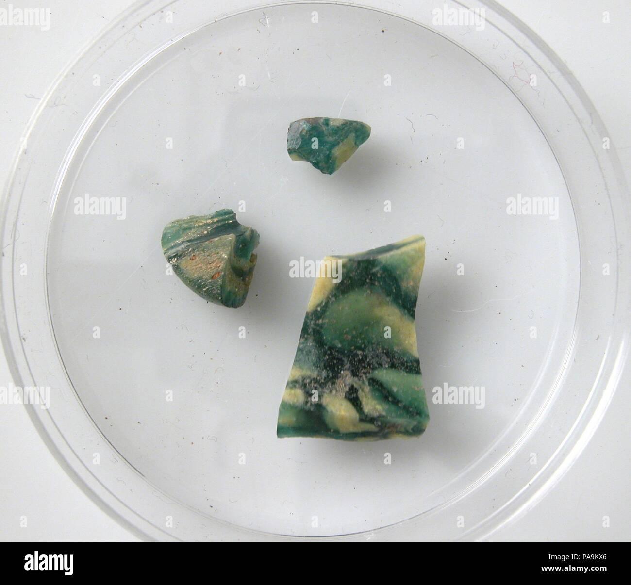 Glass Fragments. Culture: Coptic. Dimensions: Storage (petri dish diam.): 2 3/16 in. (5.5 cm). Date: 4th-7th century. Museum: Metropolitan Museum of Art, New York, USA. - Stock Image