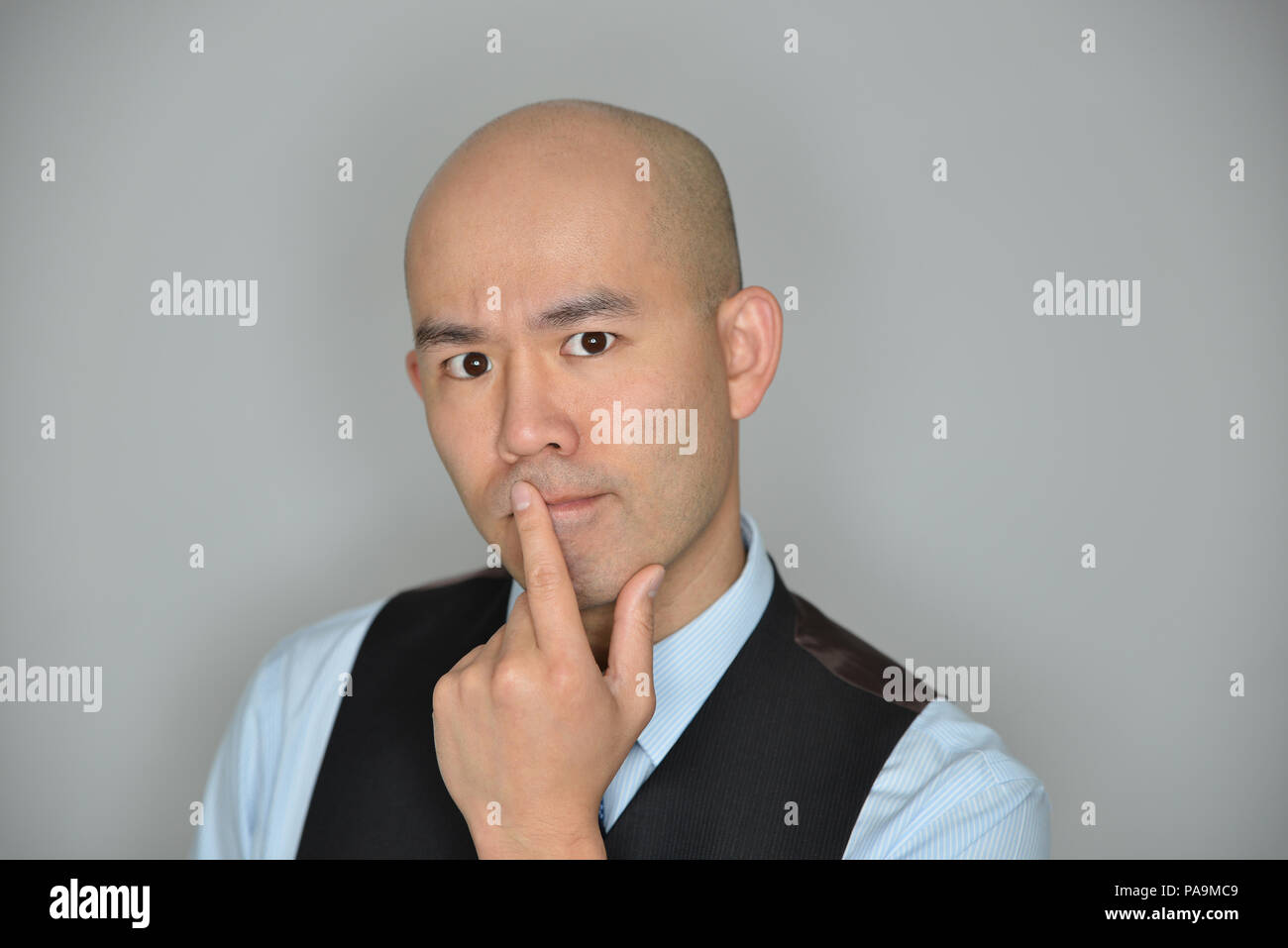 Businessman Confused and Perplexed Expression Isolated on Grey - Stock Image