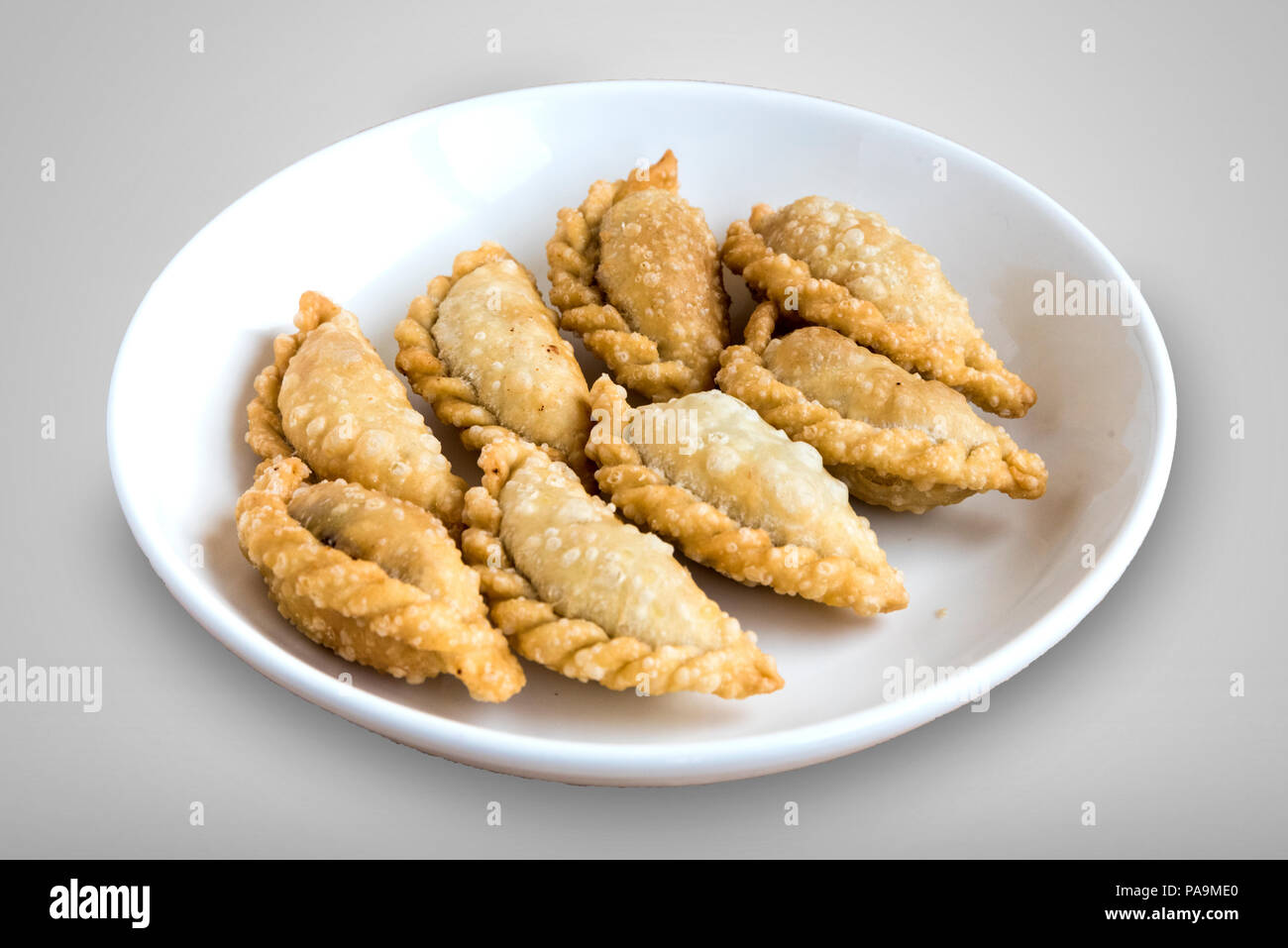 Gujiya is a sweet deep-fried dumpling served during festivals of Holi and Diwali - Stock Image