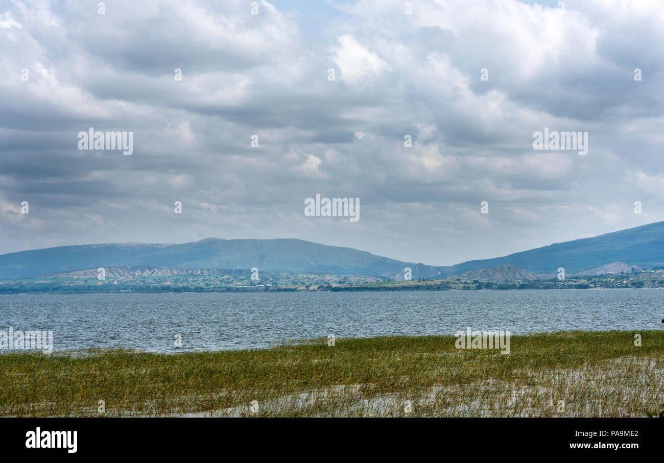 The Beautiful Awassa Lake surrounded by lush vegetation and mountains at a distance in South Addis Ababa Ethiopia - Stock Image