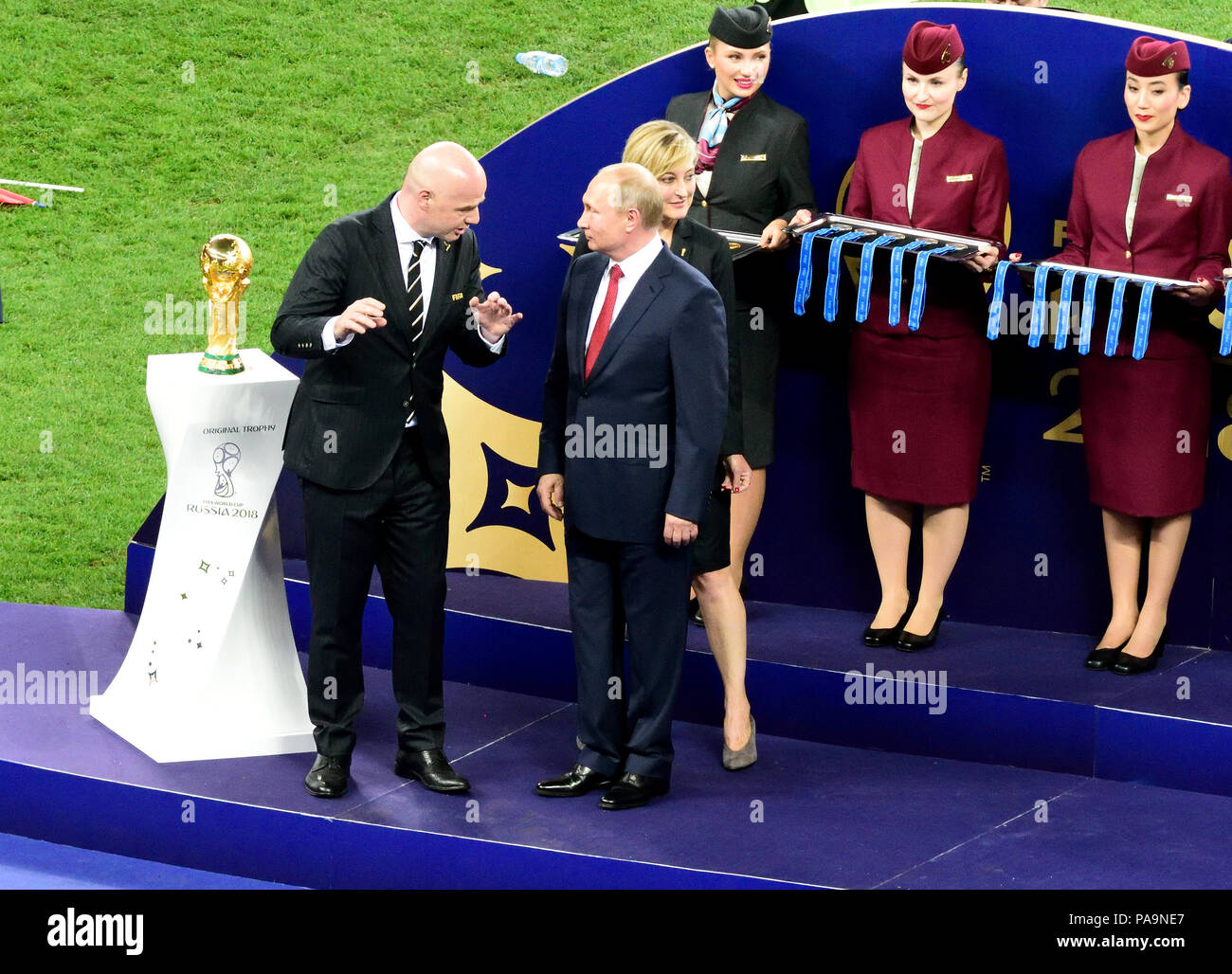 Moscow, Russia - July 15, 2018. Russian President Vladimir Putin standing by FIFA President Gianni Infantino before World Cup trophy presentation afte - Stock Image