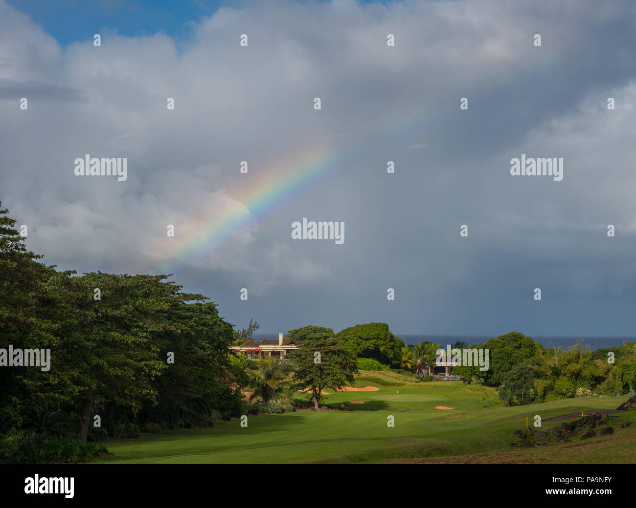 Rainbow over golf course in Mauritius - Stock Image