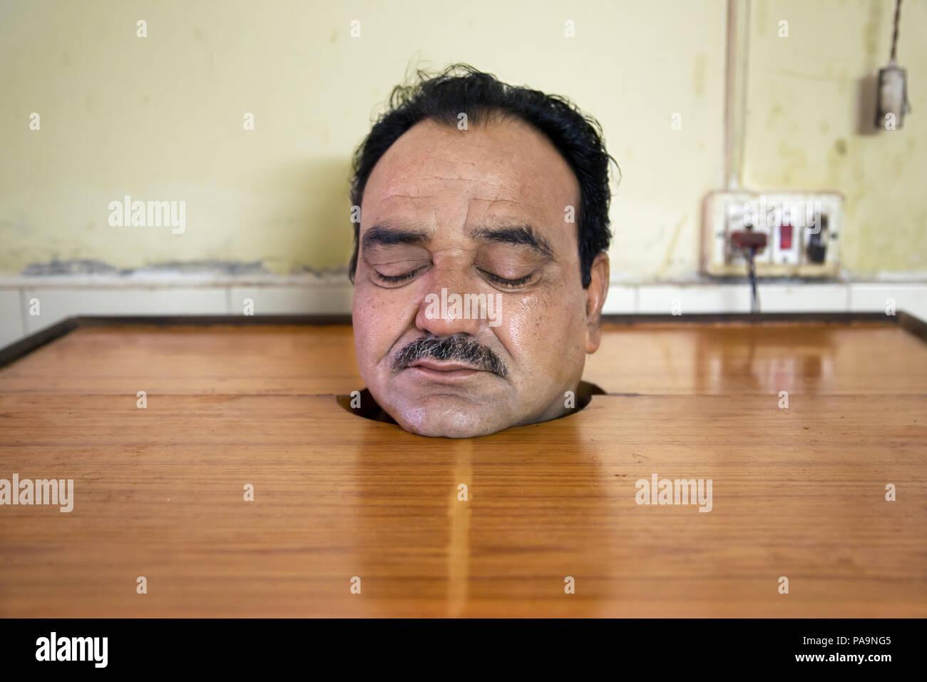 Ayurvedic treatment  (steam cabinet ) of ill man at Sambhavna Trust Clinic in Bhopal , India - Stock Image
