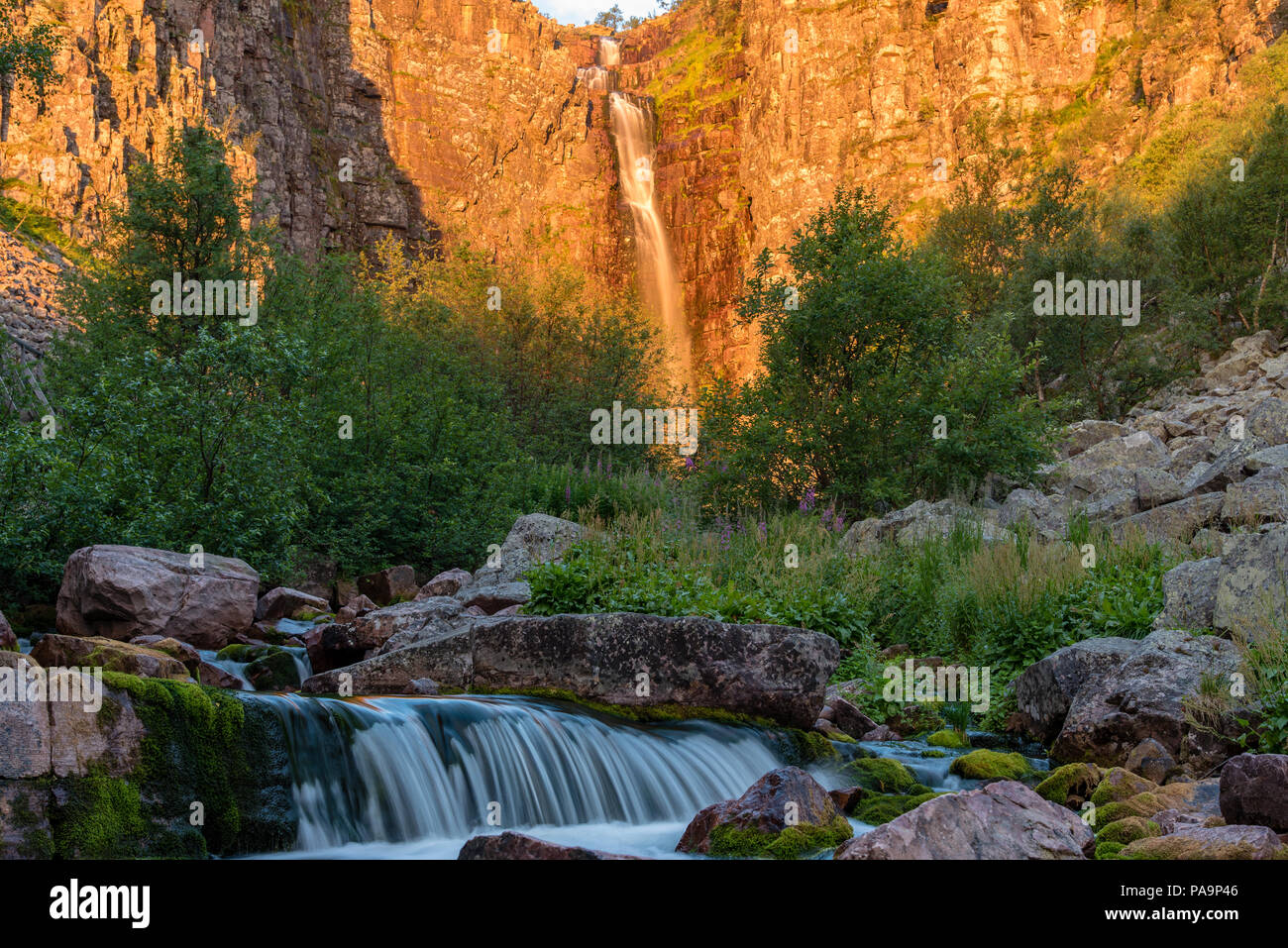 sunrise over stream and waterfall Njupeskar in Fulufjallet nature reserve in sweden - Stock Image
