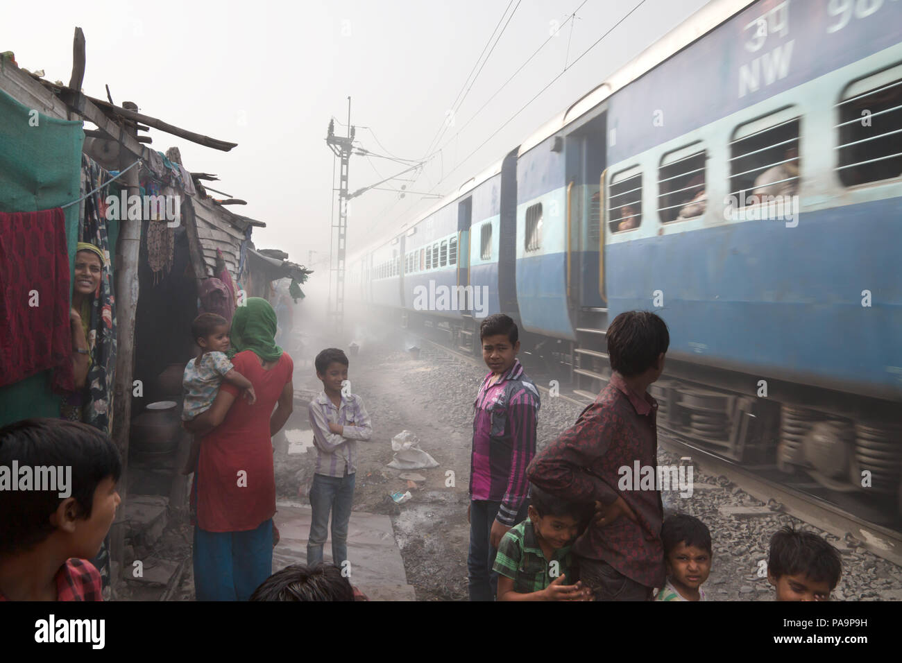 Train passing through Arif Nagar area, near the abandoned Union Carbide industrial complex, Bhopal, India - Stock Image