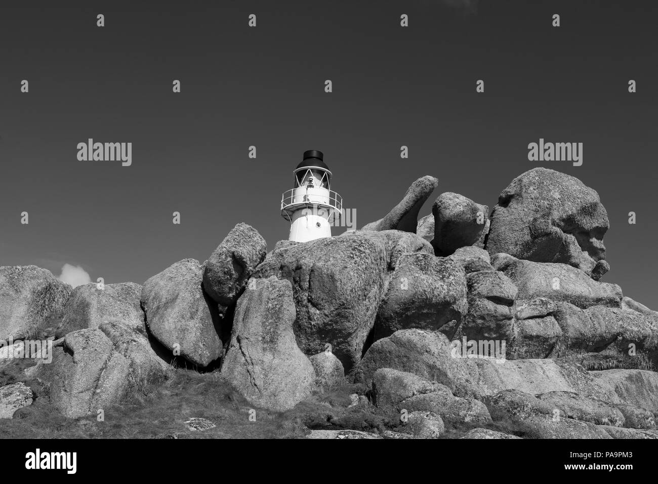 Peninnis Head lighthouse, St. Mary's, Isles of Scilly, UK: black and white version - Stock Image