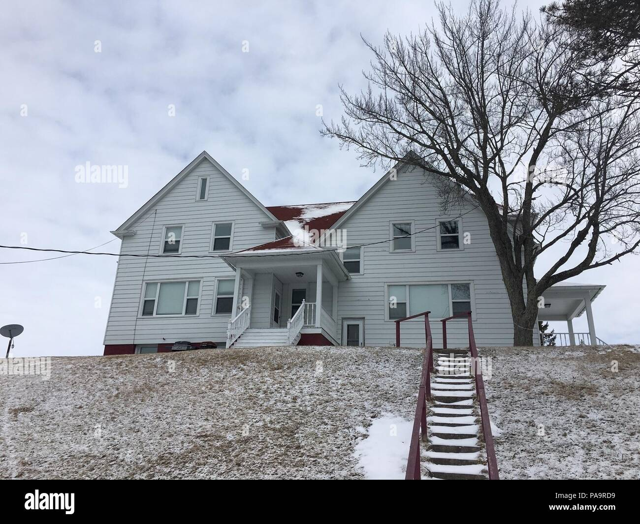 The U.S. Coast Guard is proposing to demolish this housing unit, photographed March 2, 2016, located on federal property at Coast Guard Station Sturgeon Bay, Wis. Originally built in 1896 as a lightkeeper's dwelling, the building has undergone numerous interior and exterior renovations over its history and is no longer used for housing personnel.  (U.S. Coast Guard Photo by Petty Officer 1st Class Jacob Timmons) - Stock Image