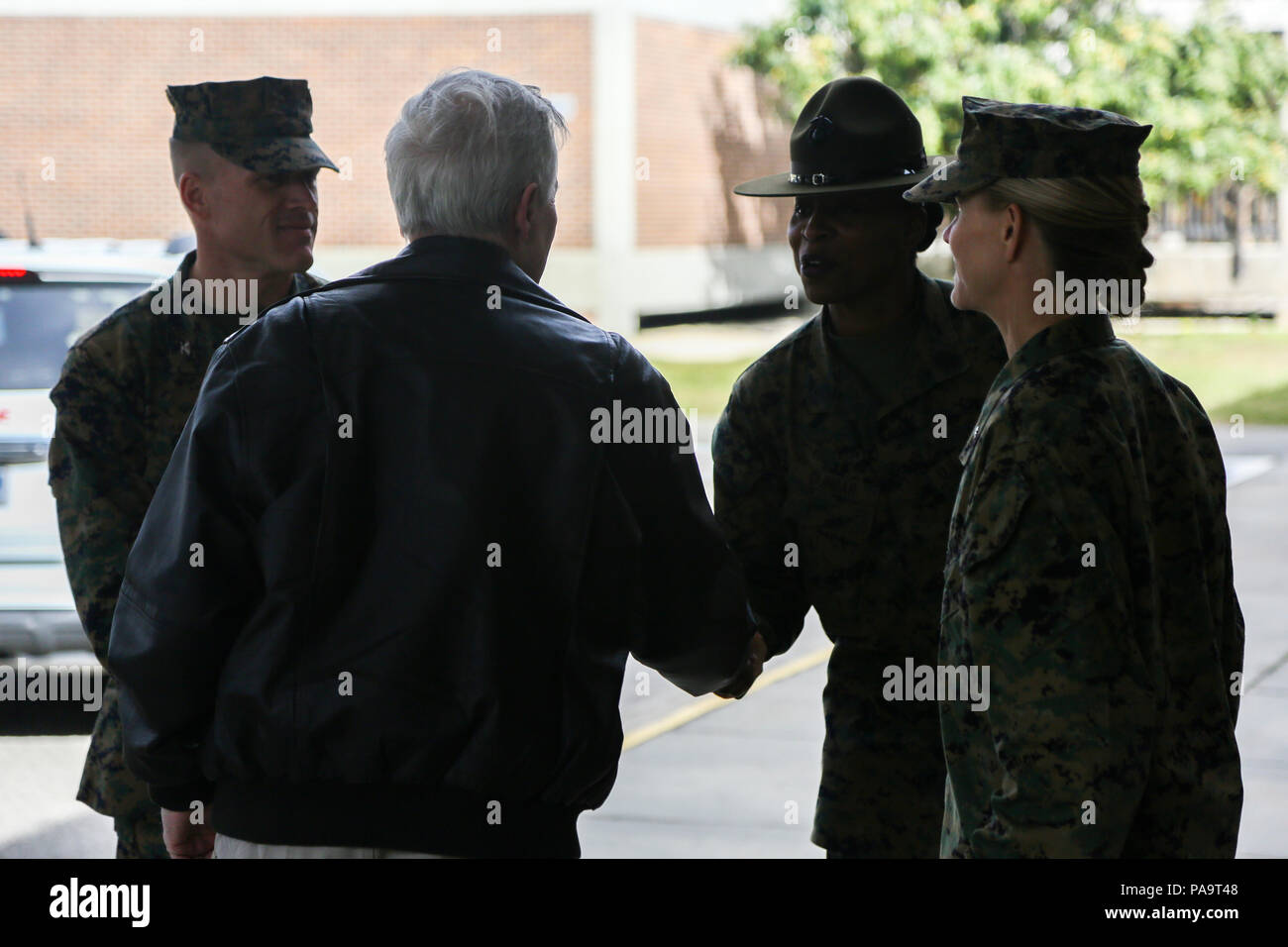 Secretary of the Navy Ray Mabus, left, shakes hands with U.S. Marine Corps Sgt. Maj. Donna A. Dunbar, sergeant major, 4th Recruit Training Battalion, Marine Corps Recruit Depot Parris Island (MCRDPI), at the 4th Recruit Training Battalion building aboard MCRDPI, S.C., March 3, 2015. Mabus visited MCRDPI in order to see firsthand how young men and women from across the country are transformed into United States Marines. (U.S. Marine Corps photo by Lance Cpl. Colby Cooper/Released) Stock Photo