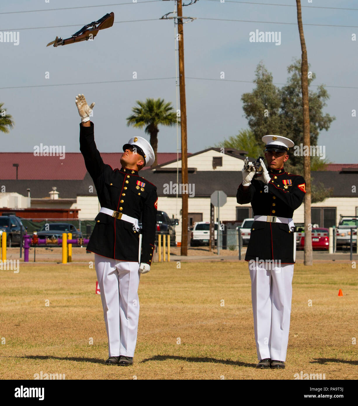 """The United States Marine Corps Silent Drill Platoon holds a performance for station military personnel and families at Marine Corps Air Station Yuma, Ariz., March 3, 2016. Based out of the """"Oldest Post of the Corps,"""" Marine Barracks 8th & I, Washington D.C., the revered platoon settles into Yuma every year for spring training, as they prepare for their tour of the West Coast. - Stock Image"""