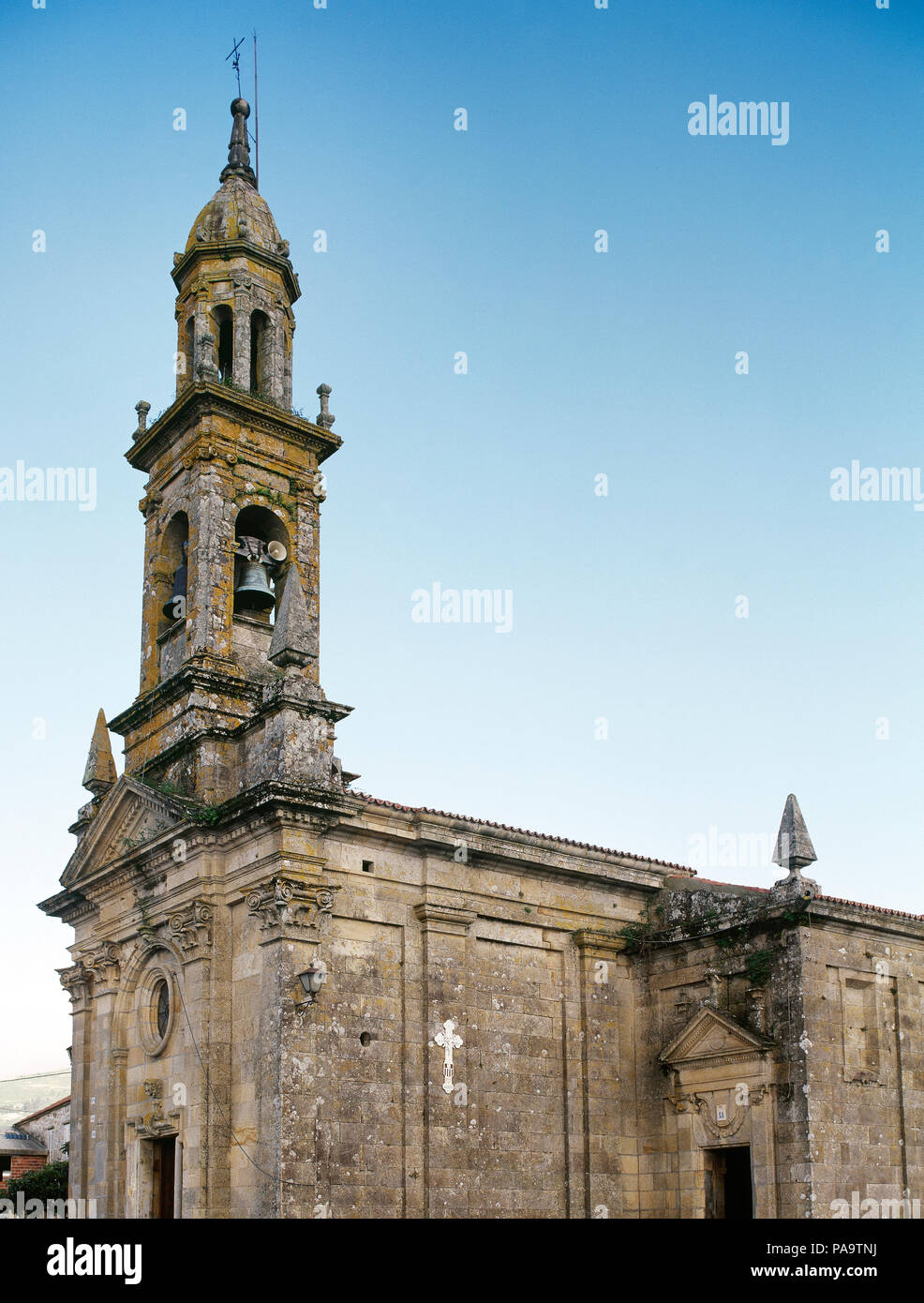 Spain, Galicia, La Coruña province, Comarca of Muros, Carnota. Santa Columba de Carnota's Church. It was built in 18th century, in classical Baroque style. The tower was added in the belfry in the 19th century, work of the master Carlos Aboy. Neoclassic forms in the main facade. - Stock Image