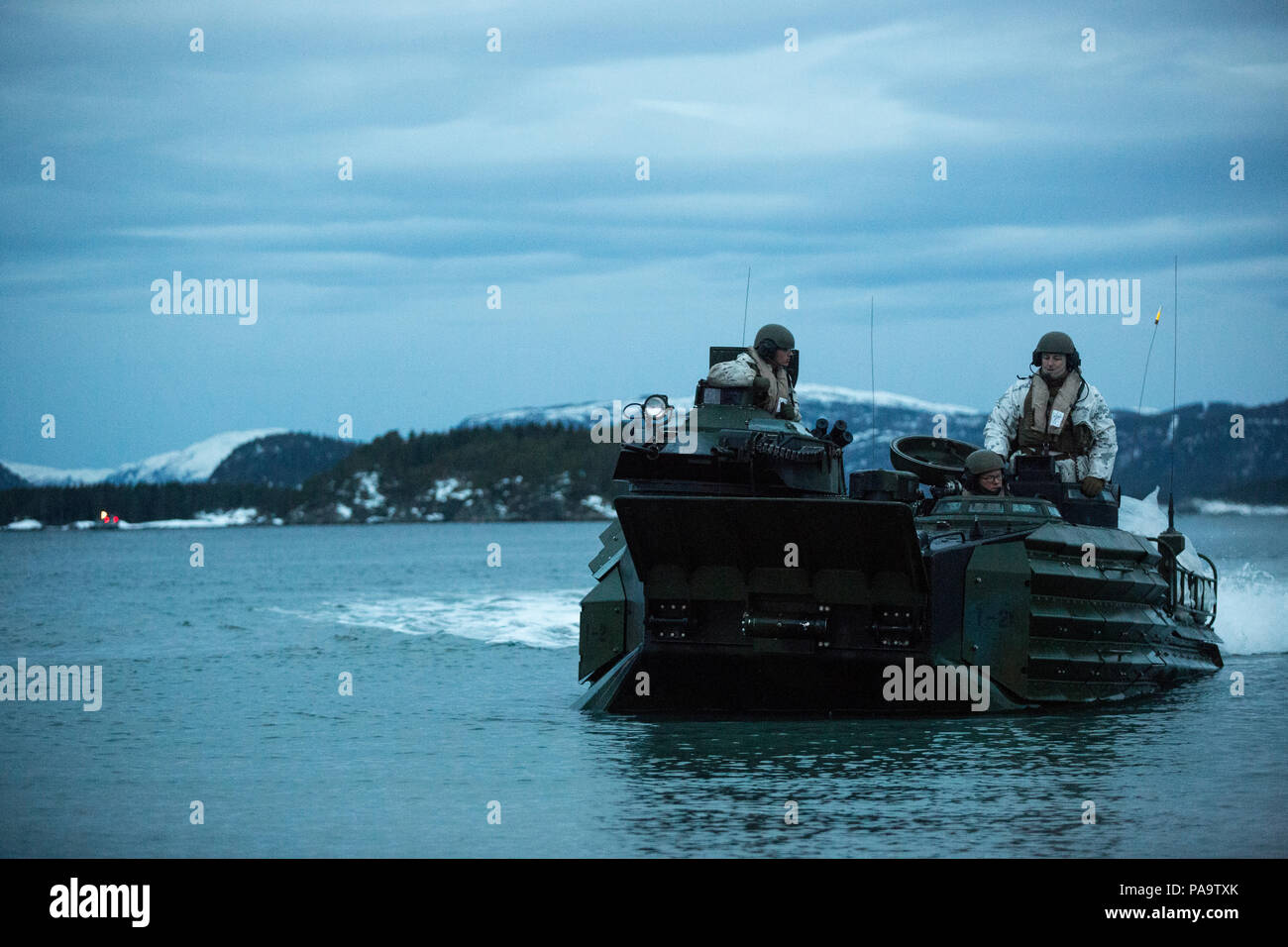 An amphibious assault vehicle prepares to make a beach landing during Exercise Cold Response 16 March 3, 2016, in Namsos, Norway.  The exercise is a Norwegian invitational comprised of 13 NATO partners and allies working together to strengthen partnerships and crisis response capabilities. (U.S. photo released by Sgt. Kirstin Merrimarahajara/Released) Stock Photo