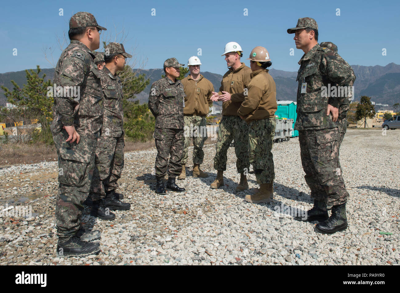 160309-N-HA376-864 BUSAN, Republic of Korea (March 9, 2016) - U.S. Navy Cmdr. Ross Campbell, assigned to the 30th Naval Construction Regiment (30 NCR), speaks with Republic of Korea (ROK) Rear Adm. Won Lae Cho, commander, Naval Education Training Group 2, after a tour of 30 NCR's combat operations center for exercise Foal Eagle 2016. 30 NCR is forward deployed to provide command and control of U.S. Navy Seabees working with their ROK counterparts during Foal Eagle. Foal Eagle is an annual, bilateral training exercise designed to enhance the readiness of U.S. and ROK forces, and their ability t - Stock Image