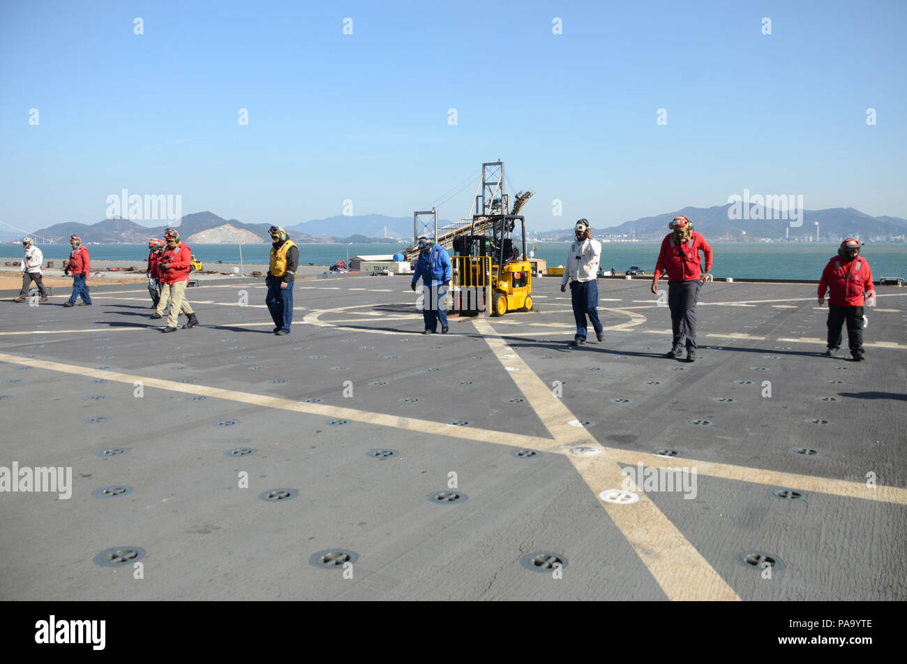 160310-N-WJ640-047 GWANGYANG, South Korea (Mar. 10, 2016)—Civilian Mariners on board dry cargo/ammunition ship USNS Sacagawea (T-AKE 2) conduct a foreign-object-damage inspection before flight operations, March 10. The Sacagewea was one of three MPF ships that offloaded her cargo in support of Exercise Ssang Yong 16, under the Exercise Freedom Banner 16 directive. (U.S. Navy photo by Mass Communication Specialist 3rd Class Madailein Abbott/Released) Stock Photo