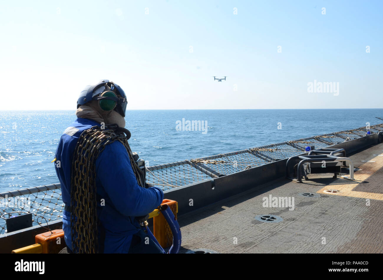160311-N-WJ640-030 GWANGYANG, South Korea (March 11, 2016)—Civilian Mariner Adrian Shuman prepares for an incoming aircraft on board dry cargo/ammunition ship USNS Sacagawea (T-AKE 2), March 11. The Sacagewea was one of three MPF ships that offloaded her cargo in support of Exercise Ssang Yong 16, under the Exercise Freedom Banner 16 directive. (U.S. Navy photo by Mass Communication Specialist 3rd Class Madailein Abbott/Released) Stock Photo