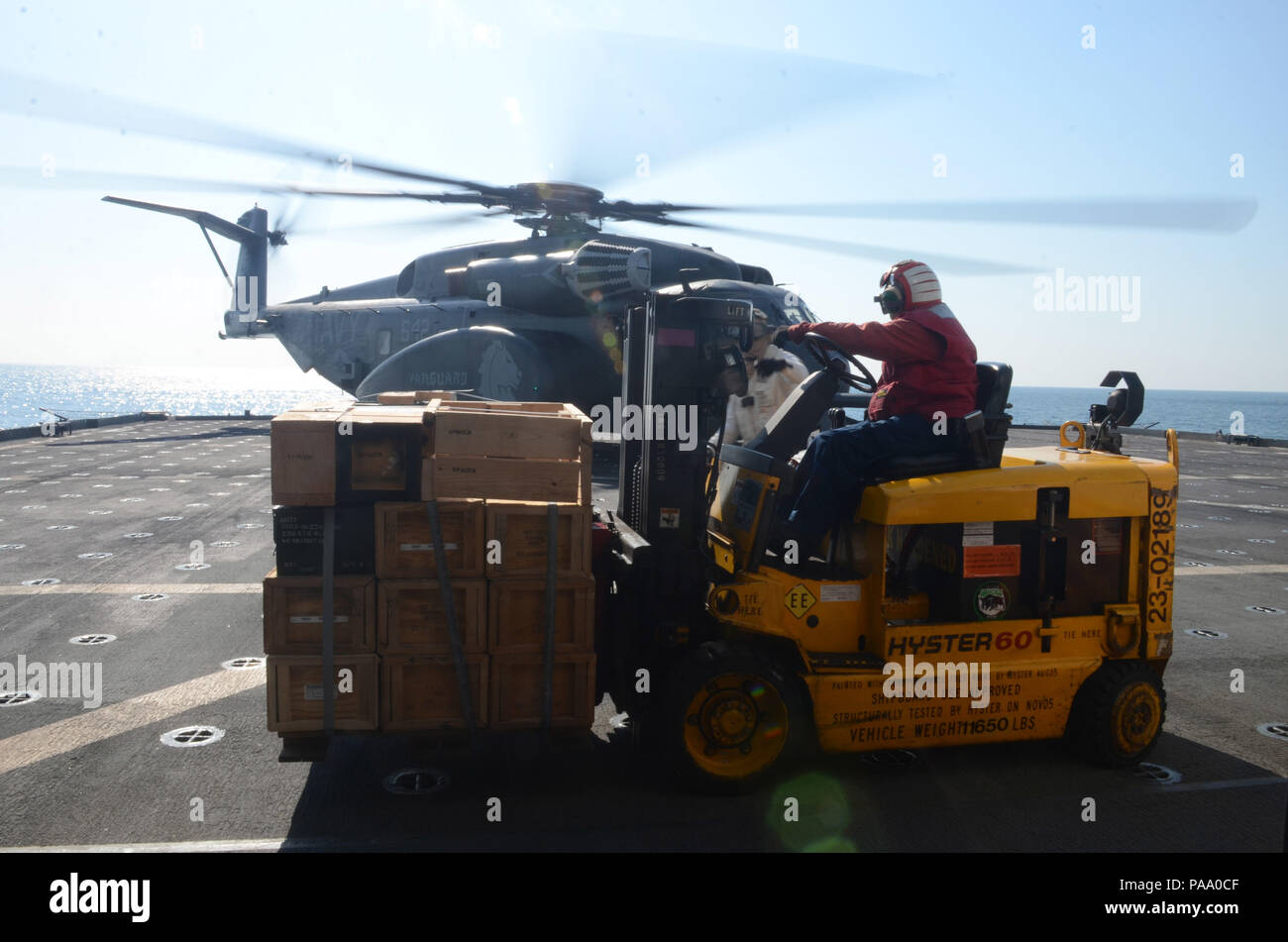160311-N-WJ640-064 GWANGYANG, South Korea (March 11, 2016)—Civilian Mariner Robert Cheong prepares to load ordnance from dry cargo/ammunition ship USNS Sacagawea (T-AKE 2) to an aircraft for transfer to Marines, March 11. The Sacagewea was one of three MPF ships that offloaded her cargo in support of Exercise Ssang Yong 16, under the Exercise Freedom Banner 16 directive. (U.S. Navy photo by Mass Communication Specialist 3rd Class Madailein Abbott/Released) Stock Photo