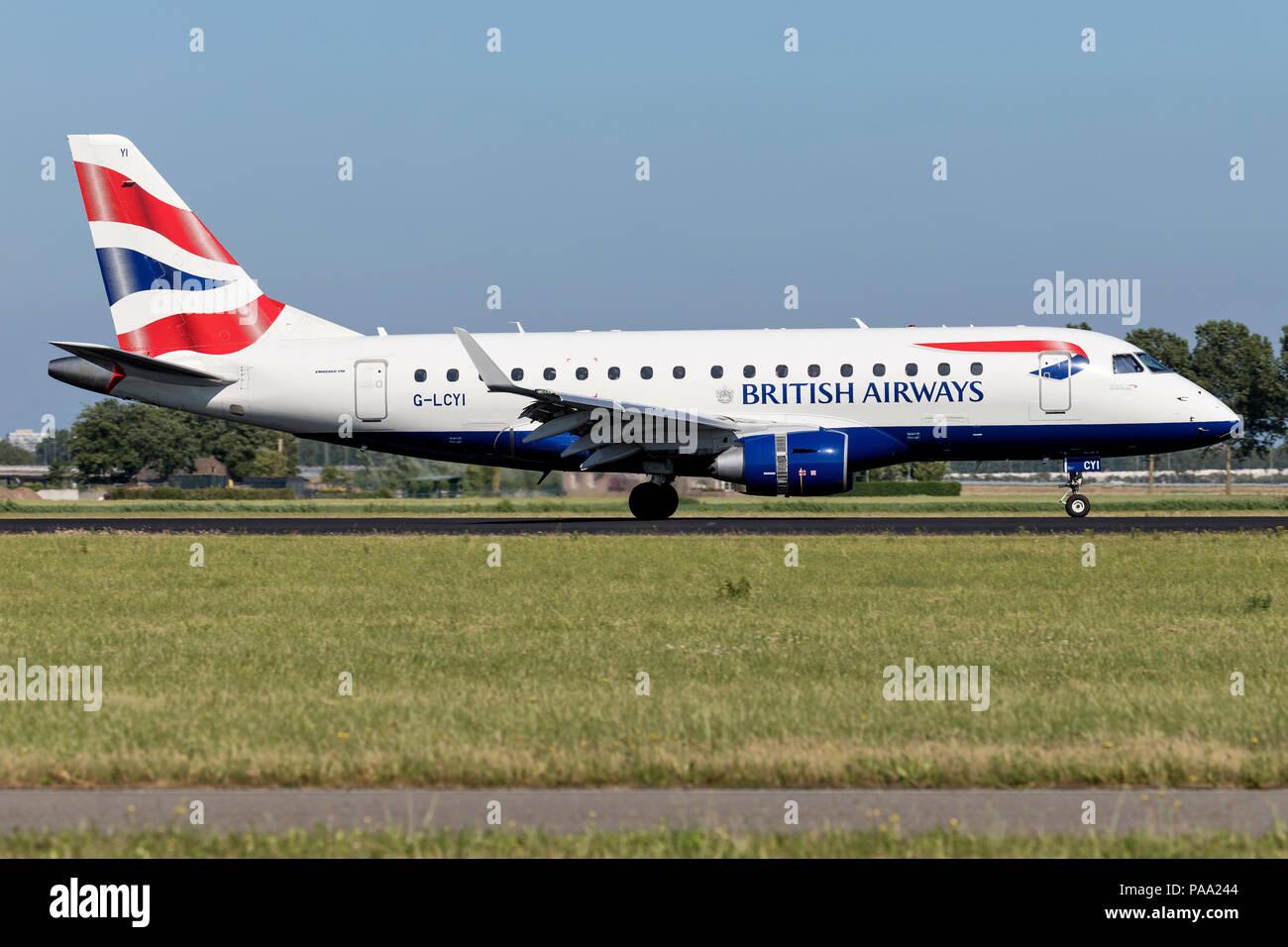 British Airways Embraer ERJ-175 (BA Cityflyer) with registration G-LCYI just landed on runway 18R (Polderbaan) of Amsterdam Airport Schiphol.Stock Photo