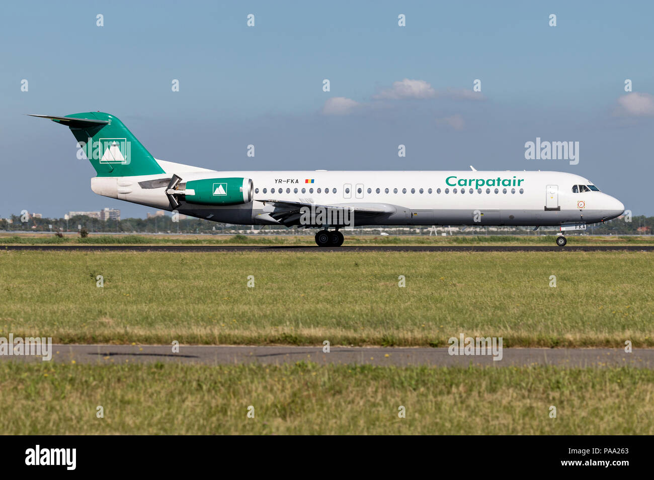Romanian Carpatair Fokker F100 with registration YR-FKA just landed on runway 18R (Polderbaan) of Amsterdam Airport Schiphol. - Stock Image