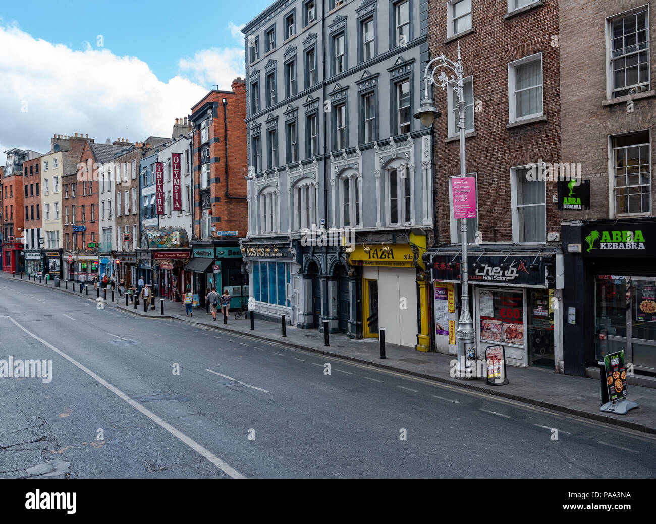 A row of flats, shops and stores in Dublin on a summer morning. - Stock Image