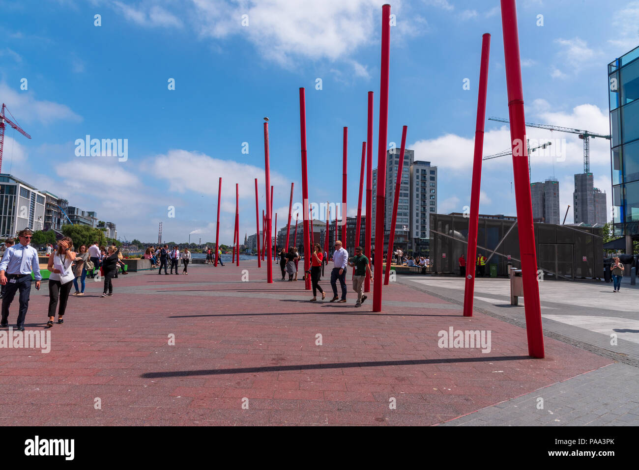 Out for a walk on a sunny summer afternoon in the smart business district - Stock Image