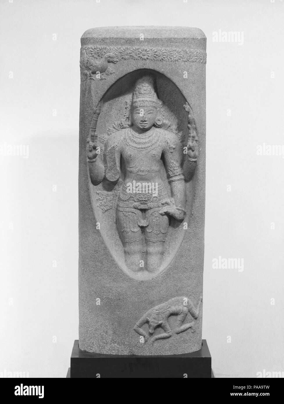 Shiva Emerging from the Linga (Lingodbhavamurti). Culture: India. Dimensions: H. 47 1/2 in. (120.7 cm); W. 18 3/4 in. (47.6 cm); D. 7 in. (17.8 cm). Date: 12th century. Museum: Metropolitan Museum of Art, New York, USA. - Stock Image