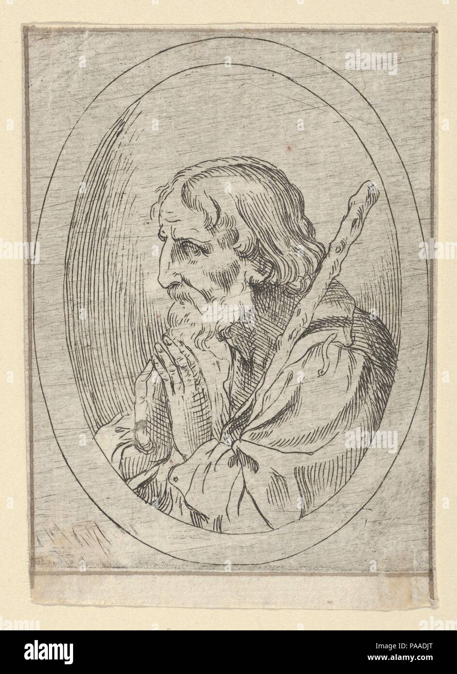 Saint Jude in prayer, seen in profile facing left with a staff ...