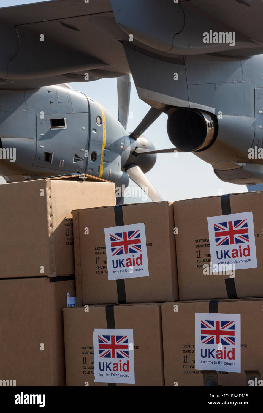 boxes of UK foreign aid packages waiting to be loaded onto a relief aircraft. UK foreign aid. - Stock Image